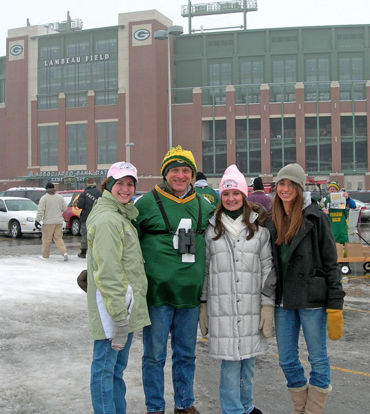 Author's daughters enjoy football game with him
