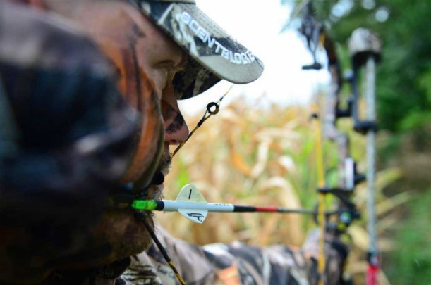 Bowhunter looking threw peep sight.