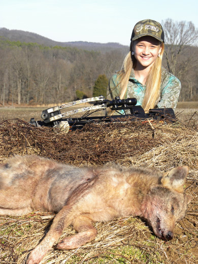 Girl with hunted Coyote