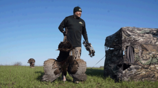 hunter-with-turkey-in-field