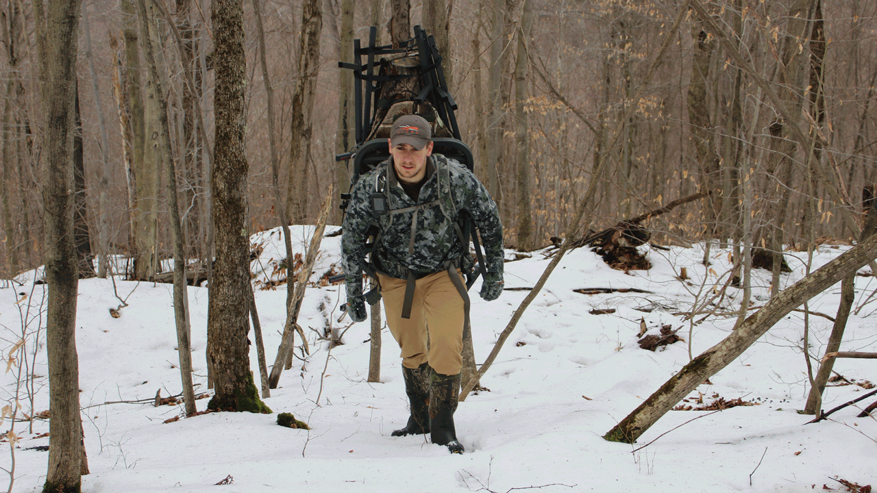 hunter-with-treestand-in-snow